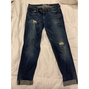 Women's dark blue jeans with rips